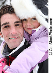 Young girl with her father on a winter's day