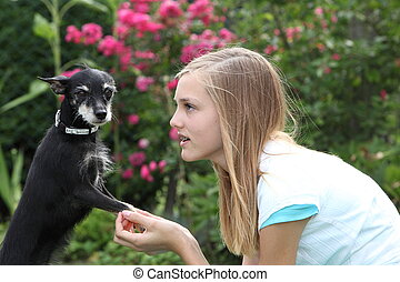 Young girl with her little dog