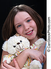 Young girl with her teddy bear
