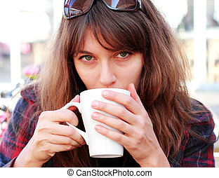 young girl with in outdoor cafe