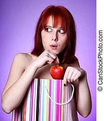 Young girl with in present box hide an apple.