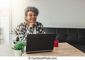 young girl with laptop at home or in the office