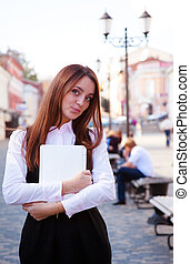 Young girl with laptop smile look at you