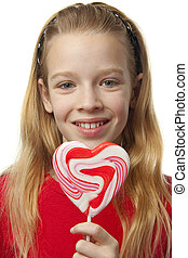 Young girl with lollipops