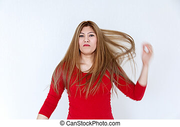 Young girl with long brown healthy hair in red