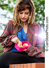 Young girl with lunch box
