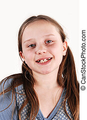 Young girl with missing teethes.