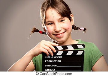 young girl with movie clapper board