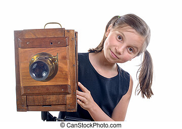 young girl with old camera