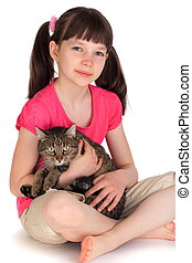 Young girl with pet cat