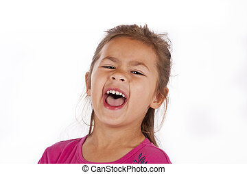 Young girl with pink dress in studio laughing