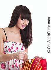 Young girl with present bag look at you