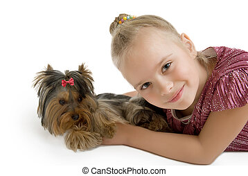 Young girl with puppy, cute Yorkshire terrier - best friends