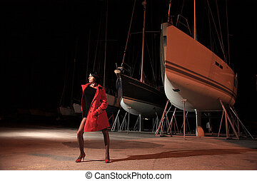 young girl with red jacket in marina