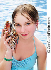 Young girl with seashell