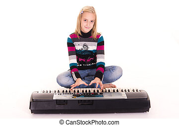 young girl with synthesizer - cute little girl with...