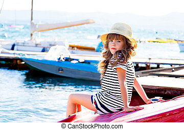 young girl with the boat
