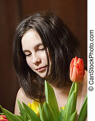 Young girl with tulips.