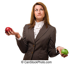 Young girl with two apples. Studio shot over white background