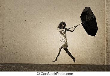 Young girl with umbrella. Photo in old color image style.