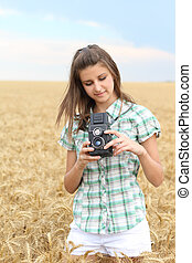 Young girl with vintage camera - Young brunette girl in the ...