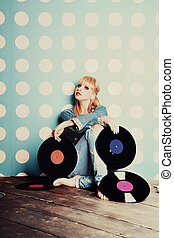 Young girl with vinyl records