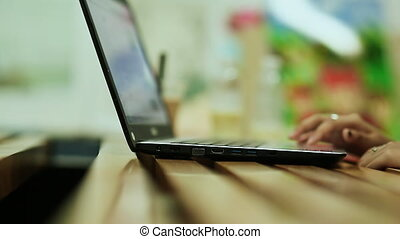 Young girl working with laptop at home.
