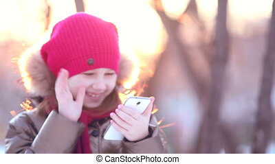 young girl writes on the phone