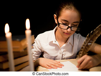 Young girl writing with feather