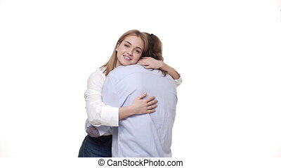 young girlfriend happy hug her boyfriend over white studio background.