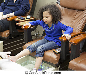 young girln at the beauty spa getting pedicures