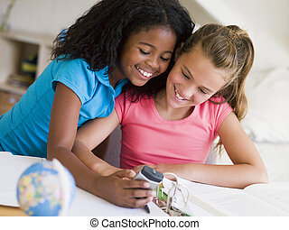 Young Girls Distracted From Their Homework, Playing With A ...