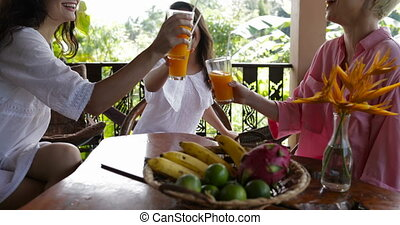 Young Girls Group Toasting Glasses With Juice During...