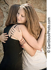 Young Girls Hug - Two teen Girls embracing and comforting...