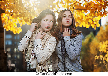 Young girls in an autumn park