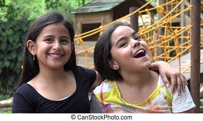 Young Girls Posing to Camera