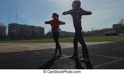 Exercise for warming the muscles - Young girls spend...