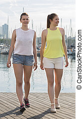 young girls standing on berthand and smiling