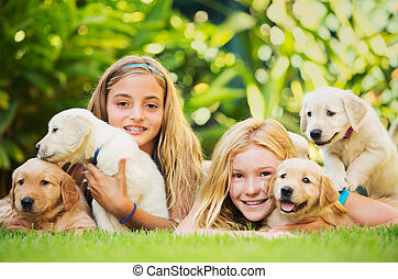Young Girls with Baby Puppies