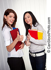 Young girls with their college portfolios - Two young women ...
