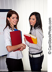 Young girls with their college portfolios