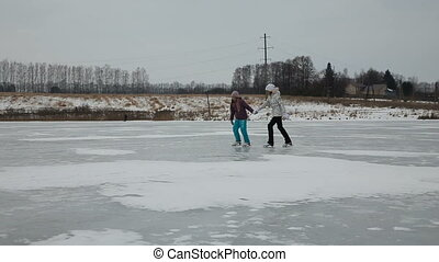 Young girlsice skating on frozen lake