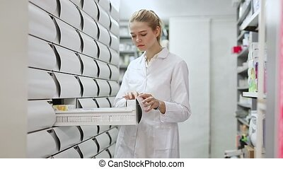 Young glad female customer searching for reliable drug in ...
