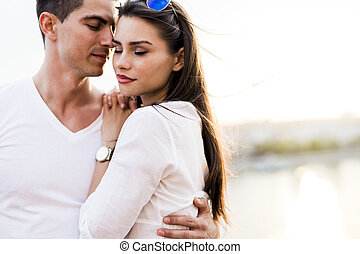 Young glamorous couple expressing sensuality