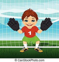 Young goalkeeper boy wearing red and green sportswear in a ready position