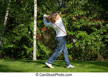 Young golf player with driver teein