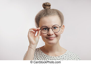 young good-looking girl wearing round glasses isolated on white background