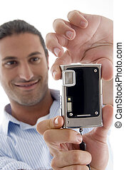 young good looking man clicking photograph with white...