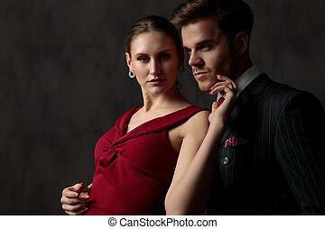 couple standing and gently touching each other