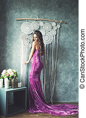 Young Gorgeous Woman Fashion Model Wearing Evening Gown